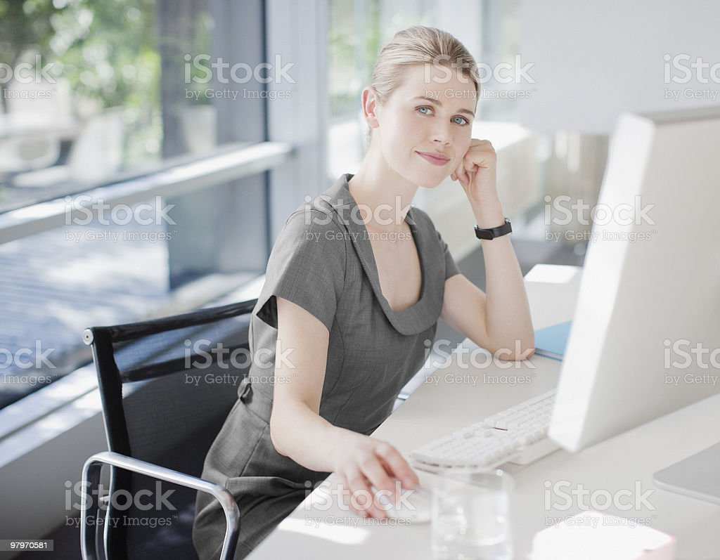 Businesswoman using computer in office royalty-free stock photo