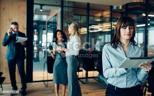 istock Businesswoman using digital device 925075248