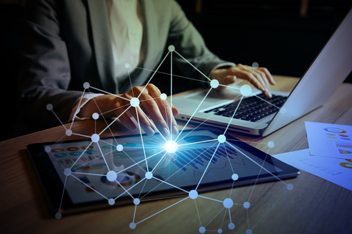 istock businesswoman using digital devices. IoT(Internet of Things). ICT(Information Communication Technology). mixed media. 861122560