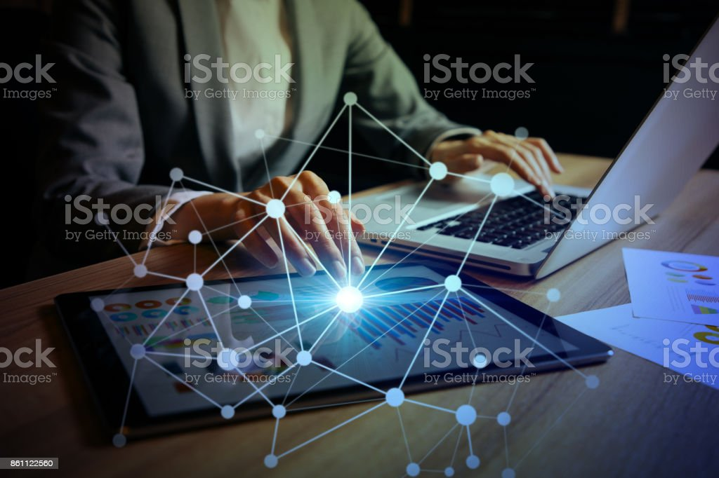 businesswoman using digital devices. IoT(Internet of Things). ICT(Information Communication Technology). mixed media. stock photo