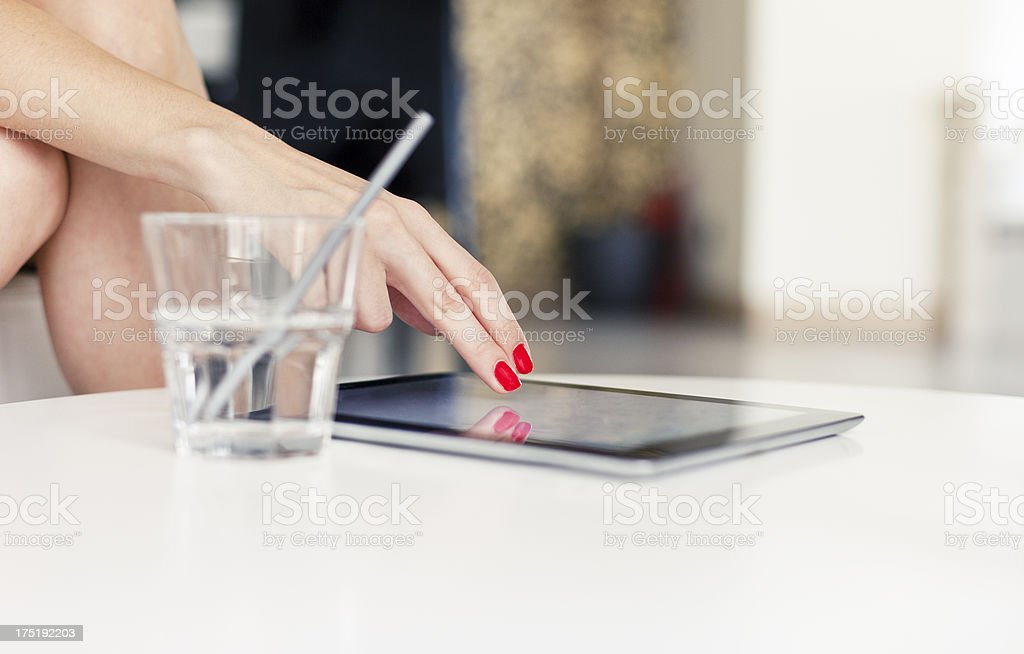 Businesswoman using digital tablet in a cafe royalty-free stock photo