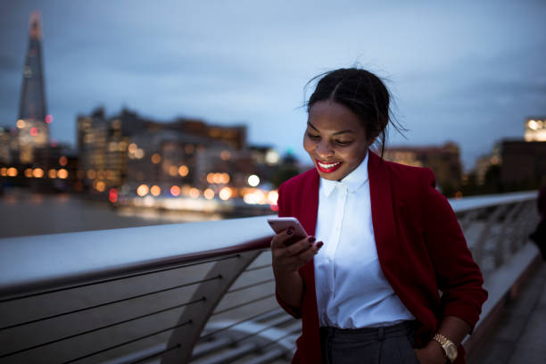 businesswoman using digital tablet - eating technology stock photos and pictures
