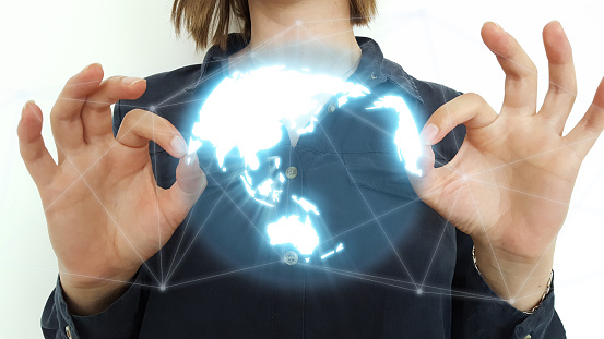 185274311 istock photo Businesswoman using globe network hologram with Europe and USA map 1164534101