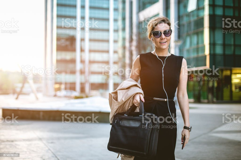 Businesswoman using headset and having a beautiful smile stock photo