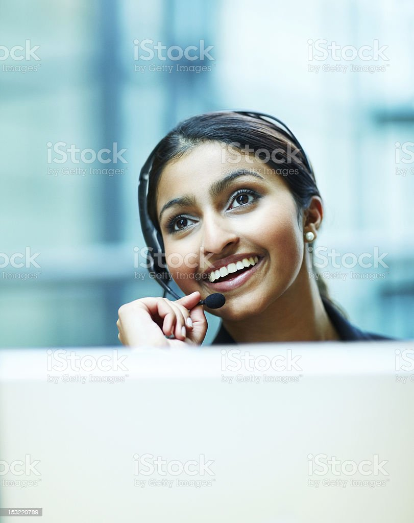 Businesswoman using headset and smiling royalty-free stock photo