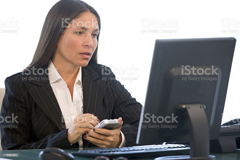 Businesswoman Using Her P.D.A. royalty-free stock photo