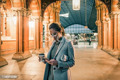 young woman using her smartphone in the city