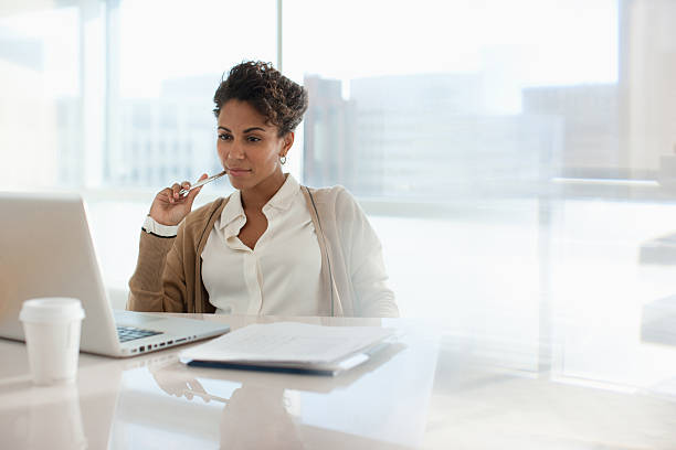 Businesswoman using laptop in office  detection stock pictures, royalty-free photos & images