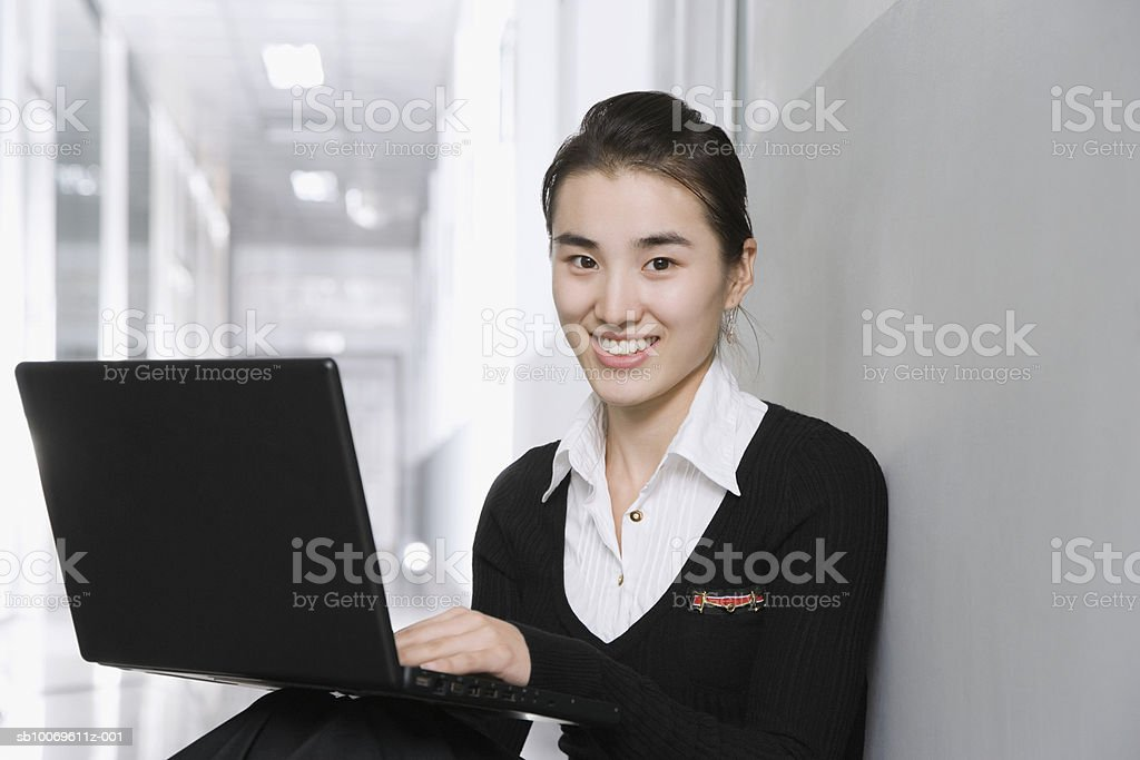 Businesswoman using laptop, smiling, portrait royalty-free stock photo