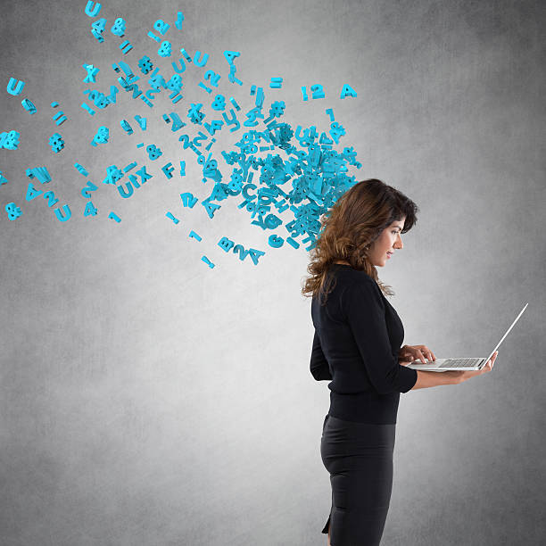 businesswoman using laptop with flying alphabets - laptop digital composite stock photos and pictures