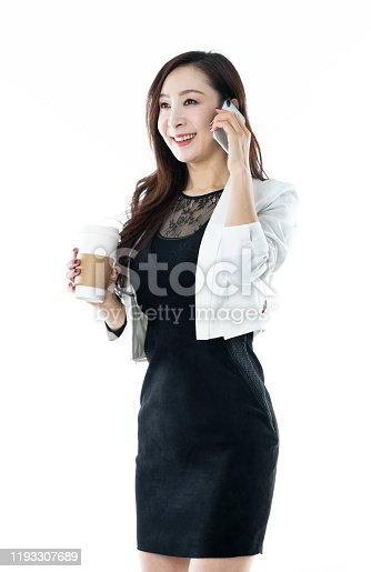 Businesswoman using mobile phone on white background.