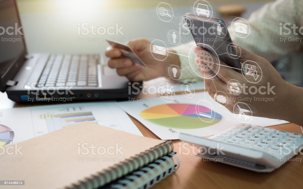 Businesswoman using mobile phone to online payment by credit card. stock photo
