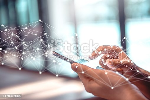 Businesswoman using mobile smartphone online to social network with connect to global cyber net.