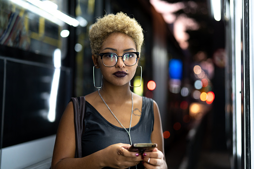 istock Businesswoman using mobile with city on background 959180436