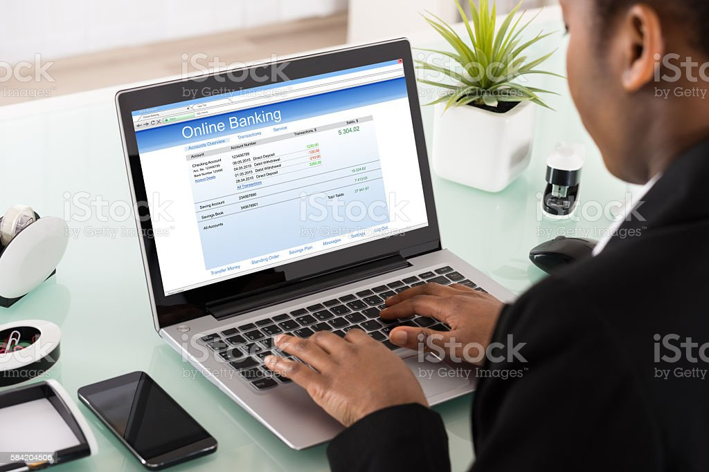 Businesswoman Using Online Banking Service On Laptop stock photo