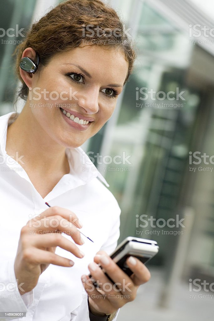 Businesswoman using palmtop royalty-free stock photo