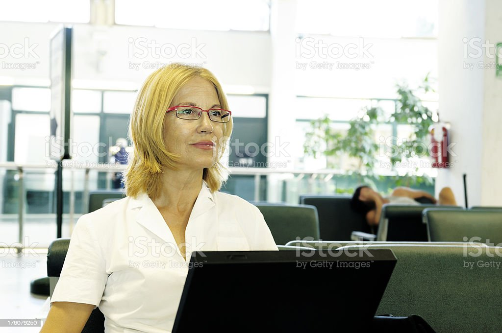 Businesswoman Using PC in Airport royalty-free stock photo