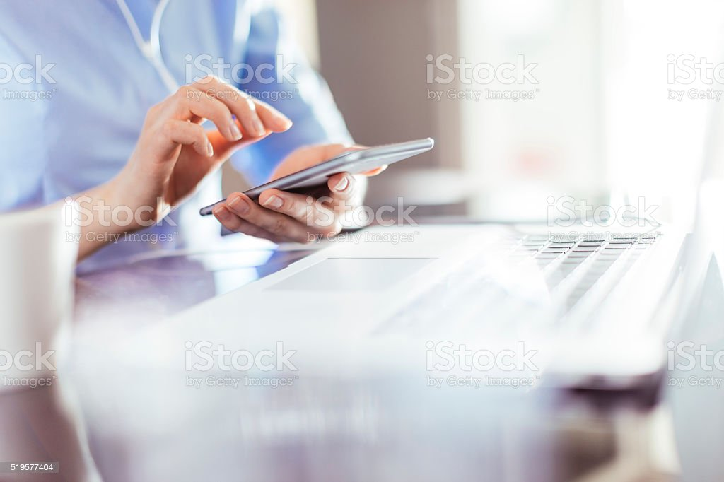 Businesswoman using smart phone royalty-free stock photo