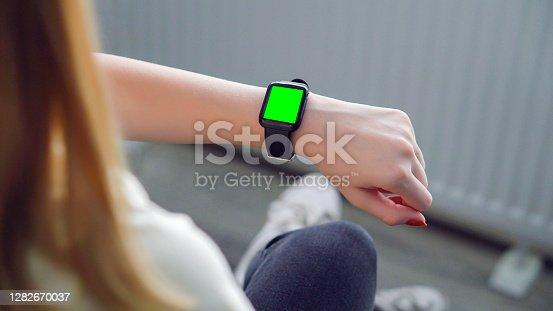 Businesswoman using smart watch. checking the hologram. smart watch, smartwatch futuristic concept