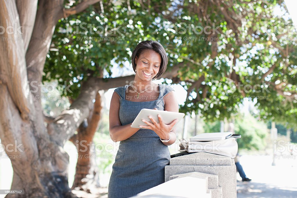 Businesswoman using tablet outdoors royalty-free stock photo