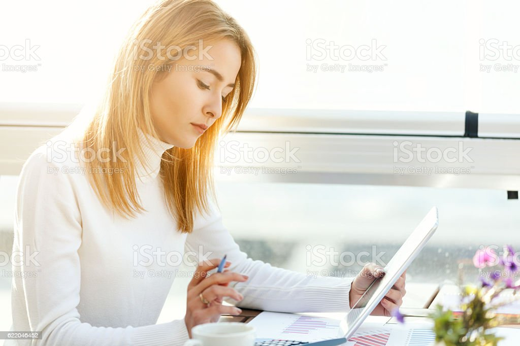 Businesswoman using Tablet stock photo