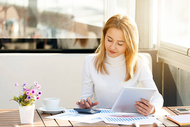 Businesswoman using Tablet Businesswoman using Tablet bureaucracy stock pictures, royalty-free photos & images