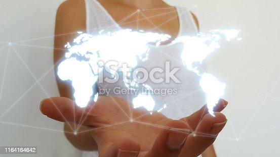 istock Businesswoman using world map interface 1164164642