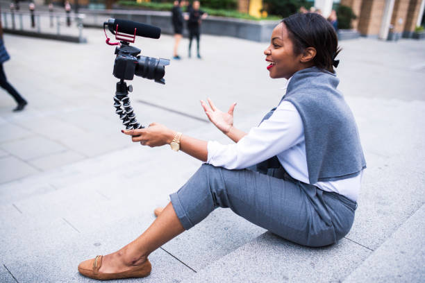 businesswoman vlogging in london - vlogger stock photos and pictures
