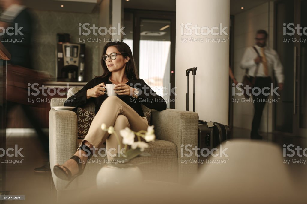 Businesswoman waiting at airport lounge stock photo