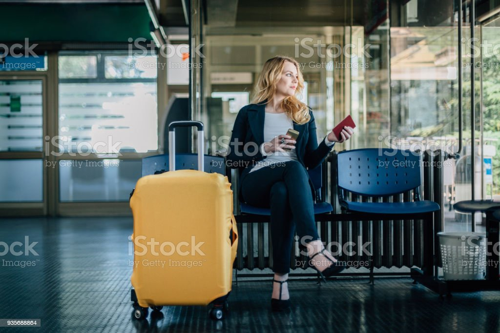 Businesswoman waiting for her flight at the airport stock photo