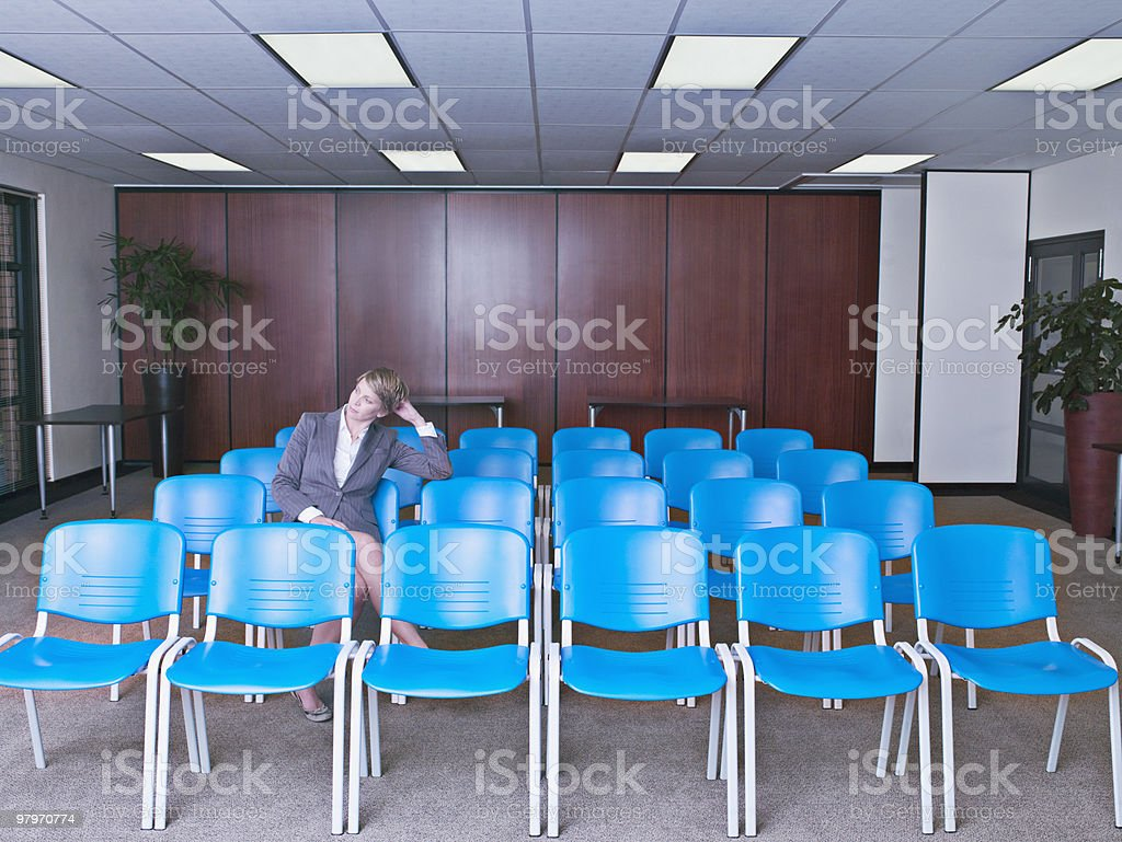Businesswoman waiting in empty conference room royalty-free stock photo