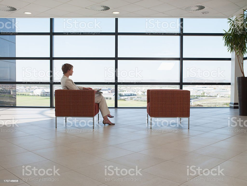 Businesswoman waiting in office waiting area