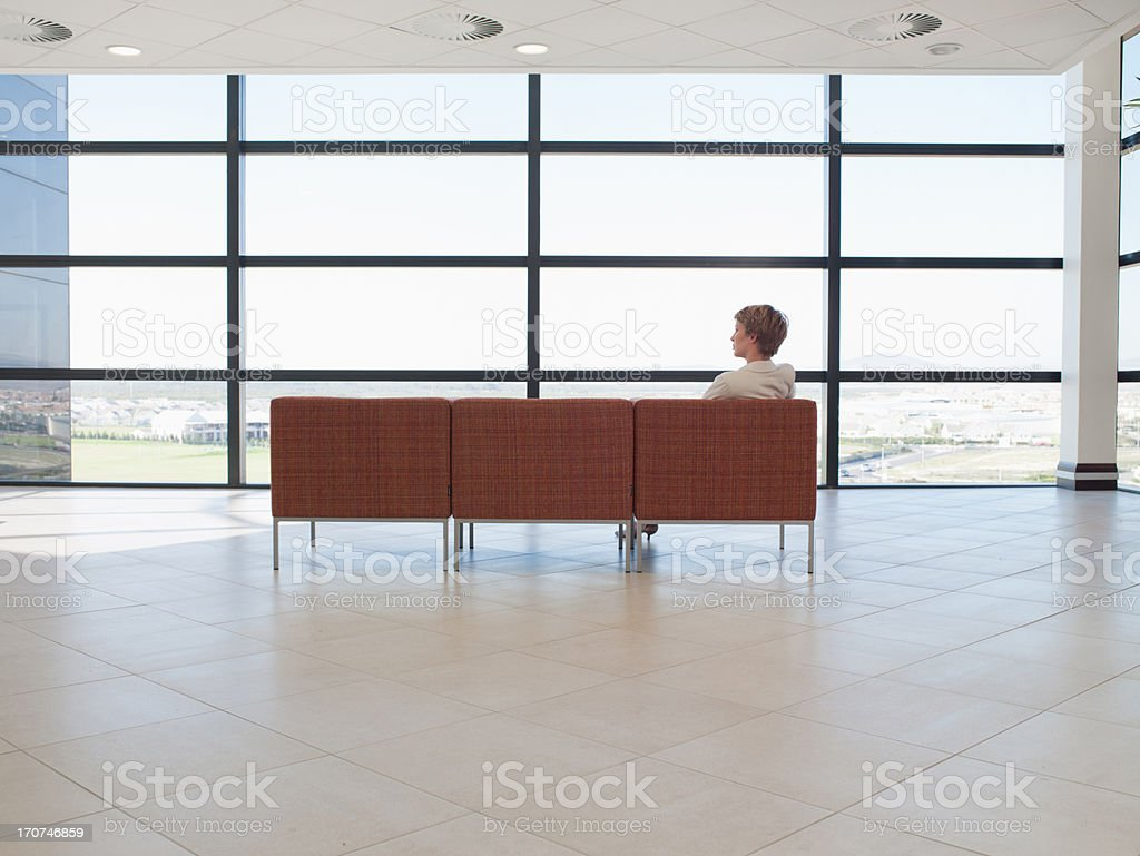 Businesswoman waiting in office waiting area royalty-free stock photo
