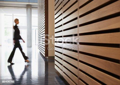 istock Businesswoman walking in corridor 85406266