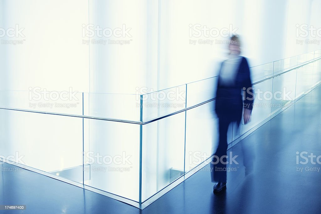 Businesswoman Walking in Modern Office Building stock photo