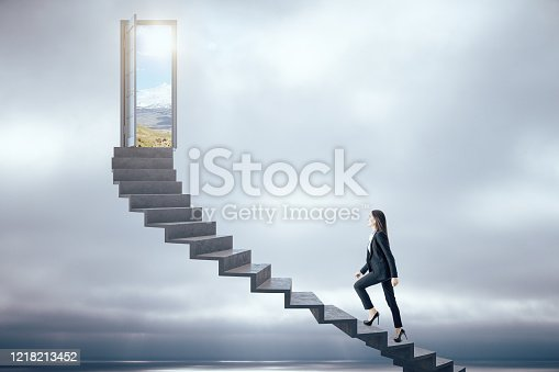 Businesswoman walking on ladder to success sky background. Leadership and success concept