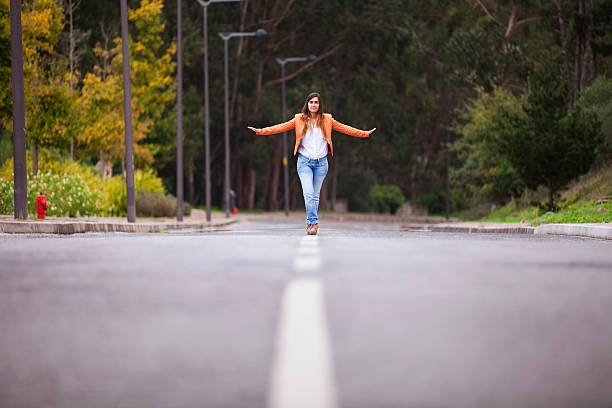 Businesswoman walking on the road stock photo