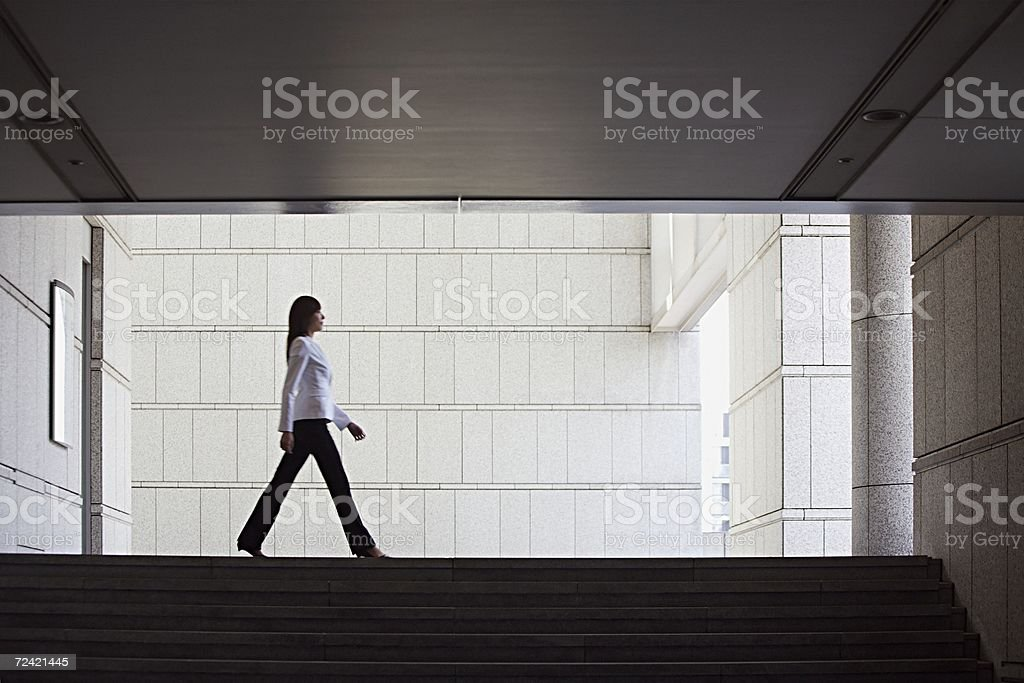 Businesswoman walking stock photo