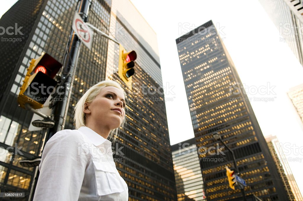 Businesswoman Walking through Downtown of City royalty-free stock photo