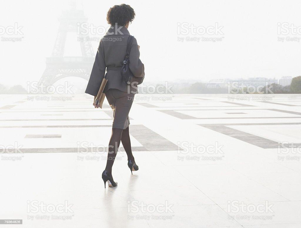 Businesswoman walking through plaza near Eiffel Tower 免版稅 stock photo