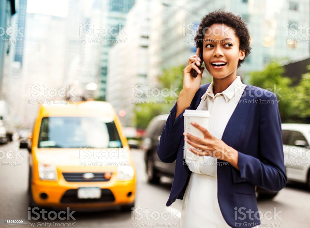 Businesswoman walking with coffee cup stock photo