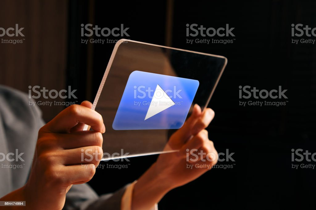 businesswoman watching a movie with transparent tablet. stock photo