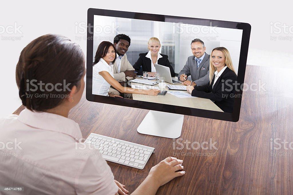 Businesswoman Watching An Online Presentation stock photo