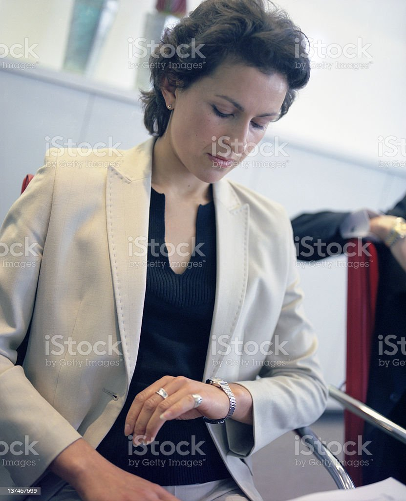 Businesswoman watching the time royalty-free stock photo