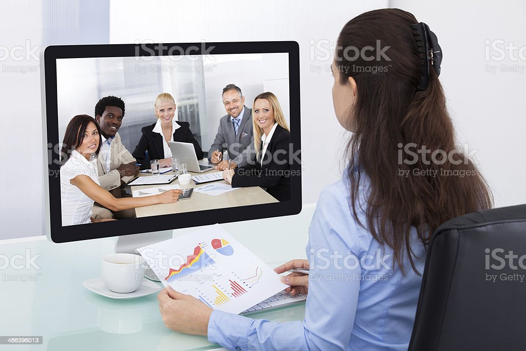 Businesswoman Watching Video Conference royalty-free stock photo