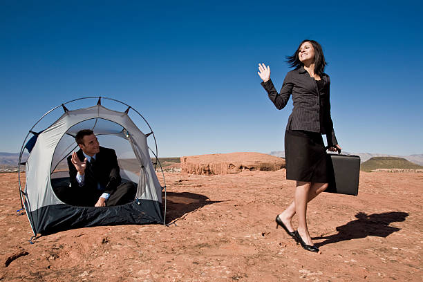 businesswoman waving goodbye from tent - waving stock photos and pictures