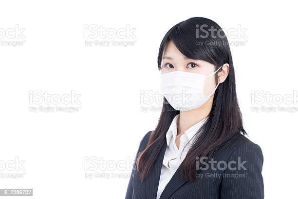 Businesswoman wearing a surgical mask picture id612389732?b=1&k=6&m=612389732&s=612x612&h=3y5s zuht53bx2w1fcnemcumczysnr3ogxmsloeebly=