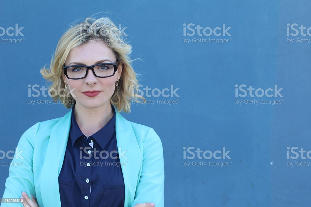 Businesswoman wearing glasses with copy space stock photo