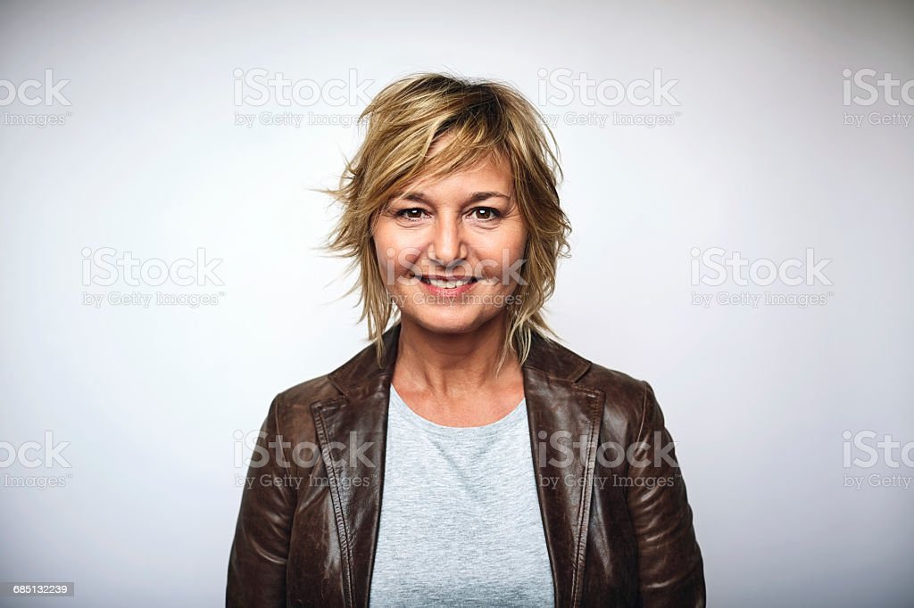 Businesswoman wearing leather jacket over white stock photo