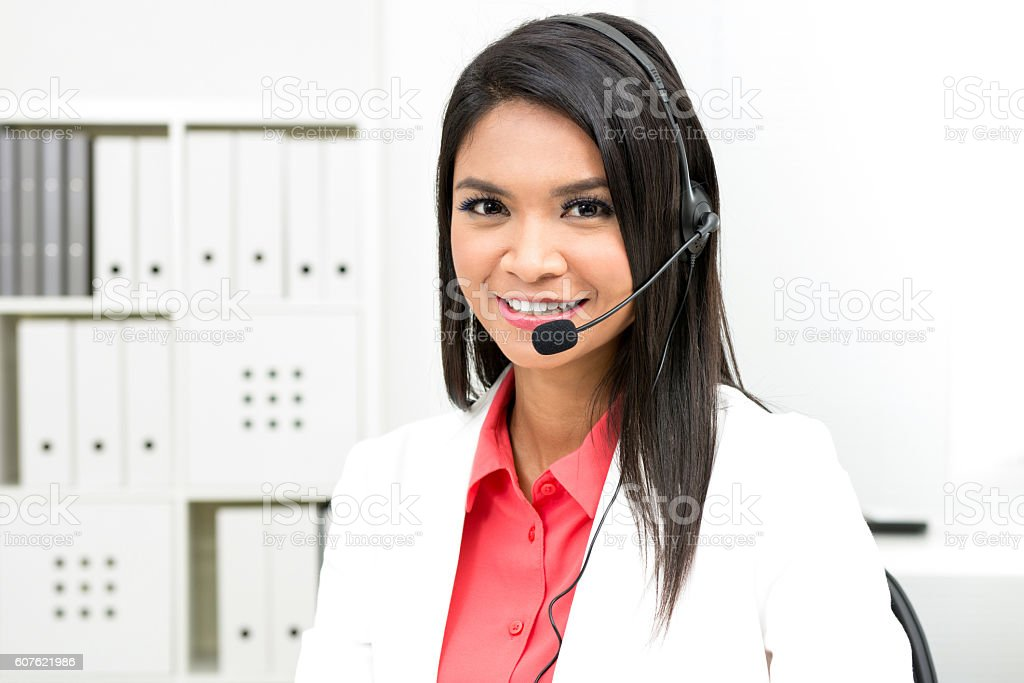 Businesswoman wearing microphone headset stock photo